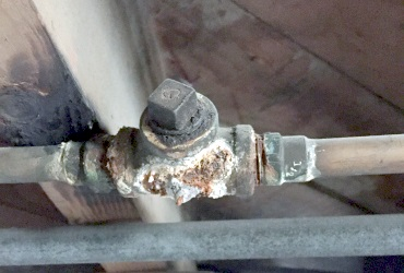 Corroded galvanized T connection